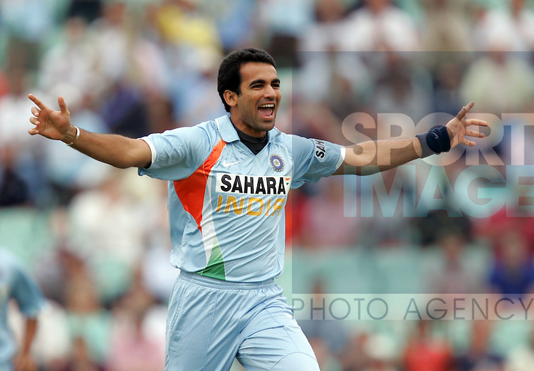 India's Zaheer Khan celebrates taking the wicket of Alastair Cook for 0. .Pic: SPORTIMAGE/David Klein