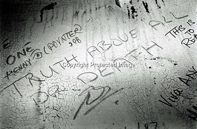 DIPOTRC00001.Polotics. TRC. A text written by Wouter Basson on a wall at Cafe Maroka while he was testifying in TRC hearings on December 6, 2002 in Cape Town, South Africa..©Per-Anders Pettersson@ iAfrika Photos