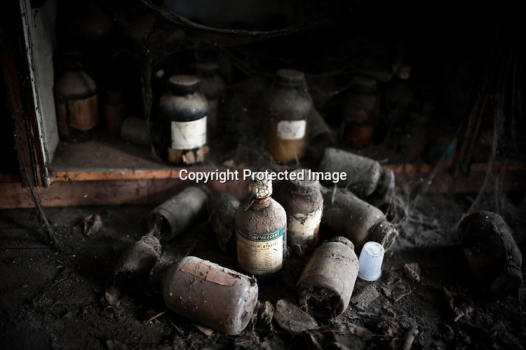 Discarded bottles of chemicals lay on the floor in a building at the site of the deserted Union Carbide factory in Bhopal, India. Twenty-five years after an explosion causing a mass gas leak, in the Union Carbide factory in Bhopal, killed at least eight thousand people, toxic material from the 'biggest industrial disaster in history' continues to affect Bhopalis. A new generation is growing up sick, disabled and struggling for justice. The effects of the disaster on the health of generations to come, both through genetics, transferred from gas victims to their children and through the ongoing severe contamination, caused by the Union Carbide factory, has only started to develop visible forms recently. Photograph: Sanjit Das