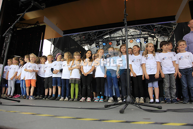Local children sing on stage at the Team Presentation in Burgplatz Dusseldorf before the 104th edition of the Tour de France 2017, Dusseldorf, Germany. 29th June 2017.<br /> Picture: Eoin Clarke | Cyclefile<br /> <br /> <br /> All photos usage must carry mandatory copyright credit (&copy; Cyclefile | Eoin Clarke)