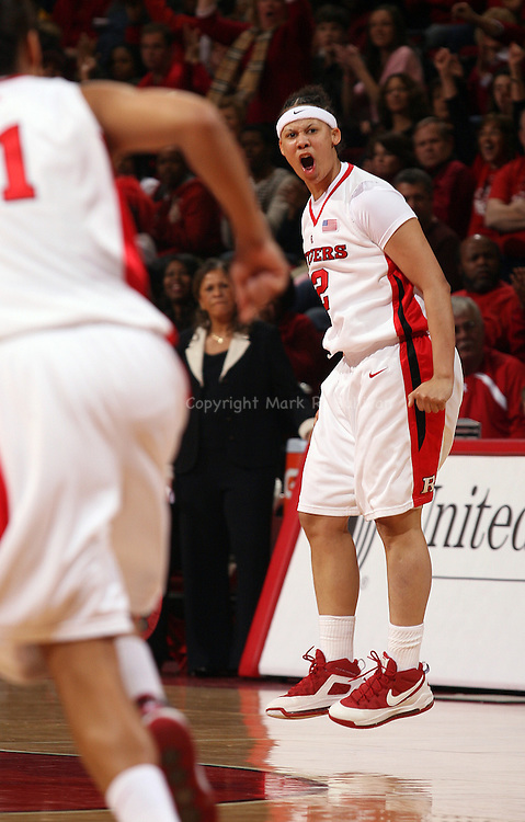 Rutgers vs University of Connecticut in Big East Women's Basketball at the Louis Brown Athletic Center, Piscataway, Nj.  Rutgers # 12 (right) April Sykes tries to rev up her team during 1st half of play vs UCONN..SPORTS.5495.ON MON MAR. 2,2009./CHIEF PHOTOGRAPHER