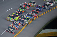 Oct. 31, 2009; Talladega, AL, USA; NASCAR Camping World Truck Series driver Kyle Busch (51) leads the field during the Mountain Dew 250 at the Talladega Superspeedway. Mandatory Credit: Mark J. Rebilas-
