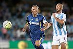 Getafe's Alexis Ruano (l) and Malaga's Nordim Amrabat during La Liga match.September 18,2015. (ALTERPHOTOS/Acero)
