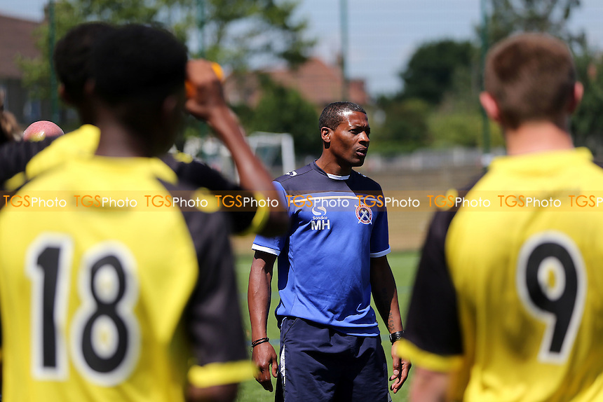 Academy coach Micah Hyde talks to the players after the game - Barking Abbey vs Dagenham & Redbridge Academy - Pre Season Friendly football at the Barking Abbey School - 04/07/15 - MANDATORY CREDIT: Dave Simpson/TGSPHOTO - Self billing applies where appropriate - 0845 094 6026 - contact@tgsphoto.co.uk - NO UNPAID USE