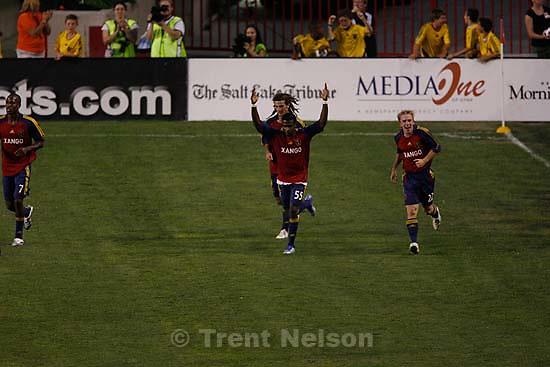 Salt Lake City - Real's Robbie Findley  celebrates his goal with teammate Jamie Watson. Real Salt Lake vs. Houston Dynamo, MLS Soccer at Rice-Eccles Stadium.