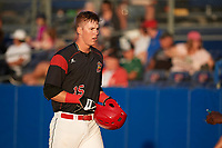 Batavia Muckdogs first baseman Sean Reynolds (15) walks to the dugout after scoring a run during a game against the Mahoning Valley Scrappers on August 16, 2017 at Dwyer Stadium in Batavia, New York.  Batavia defeated Mahoning Valley 10-6.  (Mike Janes/Four Seam Images)