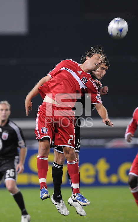 Chicago Fire midfielder Justin Mapp (21) heads the ball against DC United midfielder Chris Pontius (13). Chicago Fire tied DC United 1-1 at RFK Stadium, Saturday March 28, 2009.
