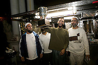 Samiul Haque Noor (2R) from Pakistan poses with friends and co-workers after being awarded the 2006 Vendy Award in New York City, USA, 22 October 2006. The annual event - a cook-off - determines the best street food vendor in the city. Haque Noor operates a cart on 73rd street and Broadway.<br />