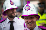 © Joel Goodman - 07973 332324 . 27/08/2016 . Manchester , UK . Policemen wearing glitterball helmets at the annual Pride Parade through Manchester City Centre as part of Manchester Gay Pride's Big Weekend . Photo credit : Joel Goodman