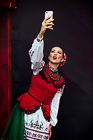 Moscow, Russia, 14/06/2018.<br /> A Cossack dancer takes a photo backstage in the Moscow Fan Zone before the opening match between Russia and Saudi Arabia in the 2018 FIFA World Cup.