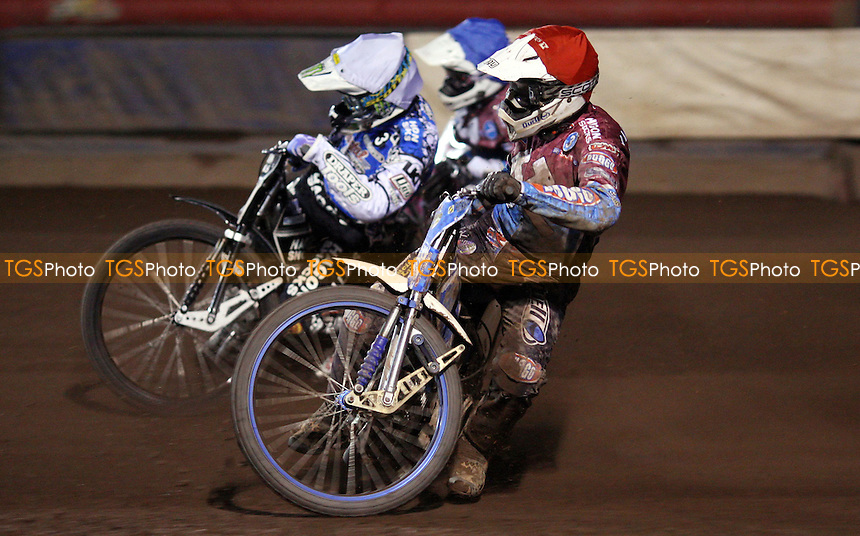 Heat 12: Kauko Nieminen (red), Darcy Ward (white) and Robert Mear (blue) - Lakeside Hammers vs Poole Pirates, Elite League Speedway Play-Off Semi-Final 1st leg at the Arena Essex Raceway, Pufleet - 24/09/12 - MANDATORY CREDIT: Rob Newell/TGSPHOTO - Self billing applies where appropriate - 0845 094 6026 - contact@tgsphoto.co.uk - NO UNPAID USE.