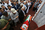 Mourners pray over the body of 14-year-old Palestinian boy Yasser Abu Al-Naja, who was killed by Israeli troops during clashes in tents protest where Palestinian demand the right to return to their homeland at the Israel-Gaza border, at a mosque during his funeral in Khan Younis, in the southern Gaza Strip June 30, 2018. Photo by Ashraf Amra