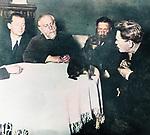 A famous tamer Vladimir Leonidovich Durov first from right demonstrating dog tests to zoology professor Grigory Kozhevnikov.