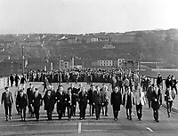 Civil rights march on its way across the Craigavon Bridge, Londonderry, N Ireland, UK, on 2 November 1968. It followed the intended route of the banned and halted march of 5 October 1968 which ended in serious violence. Although it also was an illegal march because of the 20,000+ particants the police were helpless to stop it. The march was headed by the 15 committee members of the Derry Citizens Action Committee i.e. John Hume, James Doherty, Ivan Cooper, Claude Wilton, Paddy Doherty, among others. 196811020003<br />