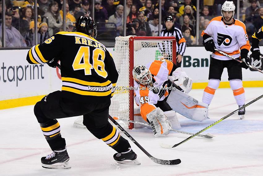 March 8, 2018: Philadelphia Flyers goaltender Alex Lyon (49) stops a shot by Boston Bruins center David Krejci (46) during the NHL game between the Philadelphia Flyers and the Boston Bruins held at TD Garden, in Boston, Mass. Boston defeats Philadelphia 3-2 in regulation time. Eric Canha/CSM