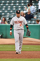 Guillermo Quiroz (41) of the Fresno Grizzlies  on defense against the Salt Lake Bees at Smith's Ballpark on April 9, 2014 in Salt Lake City, Utah.  (Stephen Smith/Four Seam Images)