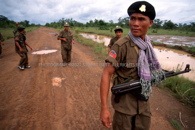 June, 1997--Samrong, Cambodia..Cambodian government troops advance north of Samrong attacking Royalists forces...All photographs ©2003 Stuart Isett.All rights reserved.This image may not be reproduced without expressed written permission from Stuart Isett.
