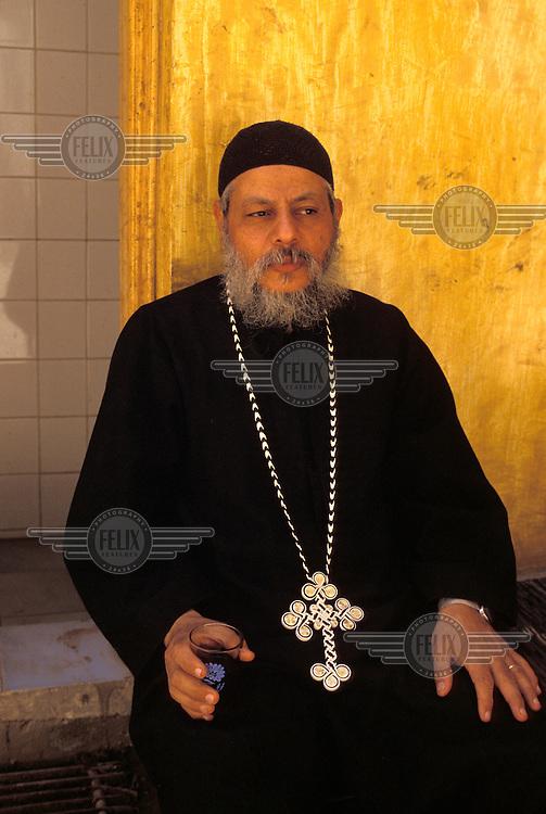 Father Sim'aan of Mokattam, a Coptic priest.