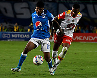 BOGOTA - COLOMBIA - 16 – 07 - 2017: Harold Mosquera (Izq.) jugador de Millonarios disputa el balón con Victor Giraldo (Der.) jugador de Independiente Santa Fe, durante partido de la fecha 2 entre Millonarios y el Independiente Santa Fe, por la Liga Aguila II-2017, jugado en el estadio Nemesio Camacho El Campin de la ciudad de Bogota. / Harold Mosquera (L) player of Millonarios vies for the ball with Victor Giraldo (R) player of Independiente Santa Fe, during a match of the date 2nd between Millonarios and Independiente Santa Fe, for the Liga Aguila II-2017 played at the Nemesio Camacho El Campin Stadium in Bogota city, Photo: VizzorImage / Luis Ramirez / Staff.