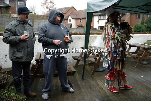Overton Mummers. Overton Hampshire UK Boxing Day Folk Play 2014. Performance at the Old House at Home pub. Under shelter due to bad weather.