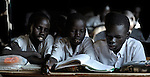 Students share a book in a classroom in Malakal, Southern Sudan. NOTE: In July 2011 Southern Sudan became the independent country of South Sudan.