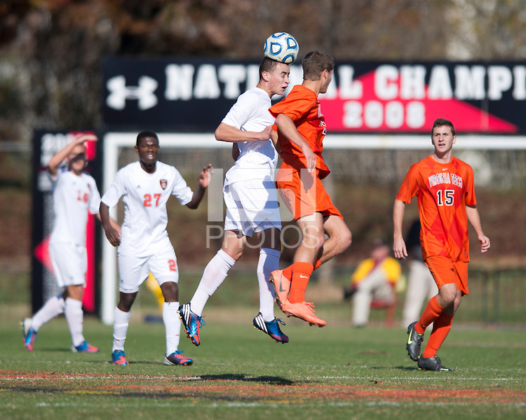 David Clemens (11) of Virginia Tech goes up for a header with Conor Agnew (6) of North Carolina State close behind during the game at Ludwig Field in College Park, MD. Virginia Tech defeated North Carolina State, 3-2, in the ACC tournament play-in game.