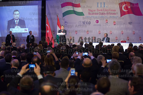 Abdullah Gul (R) president of Turkey and Viktor Orban (2nd R) prime minister of Hungary talk during a business conference in Budapest, Hungary on February 17, 2014. ATTILA VOLGYI