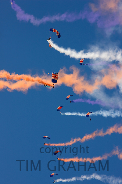 Royal Air Force parachute display with coloured smoke trails, Norfolk, United Kingdom