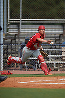 GCL Phillies East catcher Micah Yonamine (18) flips the ball for a play at the plate during a Gulf Coast League game against the GCL Yankees East on July 31, 2019 at Yankees Minor League Complex in Tampa, Florida.  GCL Yankees East defeated the GCL Phillies East 11-0 in the first game of a doubleheader.  (Mike Janes/Four Seam Images)