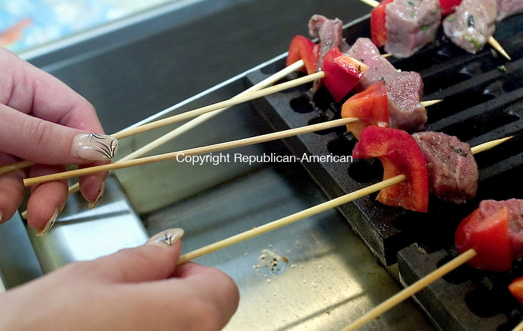 WATERBURY, CT 01 October 2008-100108SV07--Christina Slomski of Southbury grills meat skewers during an open of the new kitchen space for culinary studies at Naugatuck Valley Community College in Waterbury Wednesday.<br /> Steven Valenti Republican-American