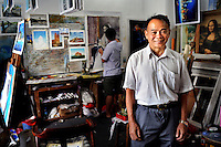 The painter and businessman Huang Jiang in his art school. In the 1990s Huang Jiang established a studio producing replicas of pieces by the world's great artists for sale overseas. This proved successful and the town attracted more and more trained artists seeking an opportunity to make a living.