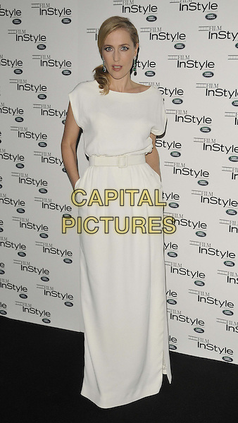 Gillian Anderson.The InStyle magazine 10th anniversary party, Sanctum Soho hotel, Warwick St., London, England..November 22nd, 2011.full length white sleeveless dress maxi hand in pocket belt  .CAP/CAN.©Can Nguyen/Capital Pictures.