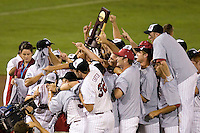 The South Carolina Gamecocks with the trophy after winning the NCAA Division One Men's College World Series on June 29th, 2010 at Johnny Rosenblatt Stadium in Omaha, Nebraska.  (Photo by Andrew Woolley / Four Seam Images)