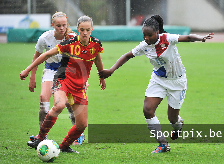 20131011 - SCHWEINFURT , GERMANY :  Belgian Chloe Vande Velde (10) pictured in a duel with Dutch Lindsey Keizerweerd (18) during the female soccer match between Belgium Women U17 and The Netherlands U17 , in the first game of the Elite round in group6 in the UEFA European Women's Under 17 competition 2013 in the Willy Sachs Stadium - Schweinfurt. Friday 11 October 2013. PHOTO DAVID CATRY