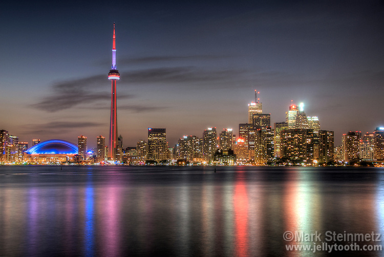View across the Inner Harbor of the Toronto skyline at twilight from Centre Island, Toronto Islands, Ontario, Canada