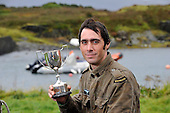 Dougie Isaacs retained his title - at the World Stone Skimming Championships which attracted over 300 entries from all round the world - Easdale is reached by a small open ferry-boat from the Isle of Seil - south of Oban - picture by Donald MacLeod - 25.9.11 - clanmacleod@btinternet.com 07702 319 738 donald-macleod.com