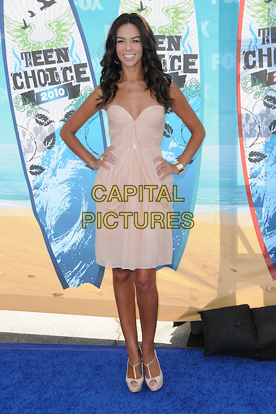 TERRI SEYMOUR.Fox Teen Choice 2010 Awards held at the Universal Ampitheatre in Universal City, California, USA..August 8th, 2010    .full length dress teri beige hands on hips pink.CAP/RKE/DVS.©DVS/RockinExposures/Capital Pictures.