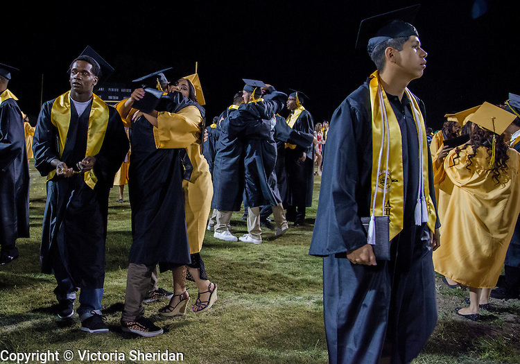 Antioch High School celebrated its graduation ceremony  of the Class of 2014 on the historic Eells Field in Antioch, California on Thursday, June 5, 2014.  Photo/Victoria Sheridan