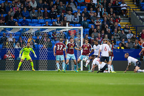 26.07.2016. Macron Stadium, Bolton, England. Pre Season Football Friendly. Bolton Wanderers versus Burnley. Goalmouth scramble for the ball with Bolton Wanderers Josh Vela, Burnley FC midfielder Scott Arfield and Bolton Wanderers forward Gary Madine.