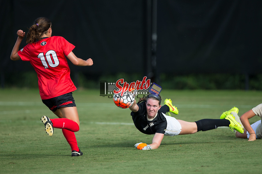 Lindsay Preston (1) of the Wake Forest Demon Deacons punches the ball away from Becca Rasmussen (10) of the Georgia Bulldogs during second half action at Spry Soccer Stadium on August 23, 2015 in Winston-Salem, North Carolina.  The Deacons defeated the Bulldogs 4-0.   (Brian Westerholt/Sports On Film)