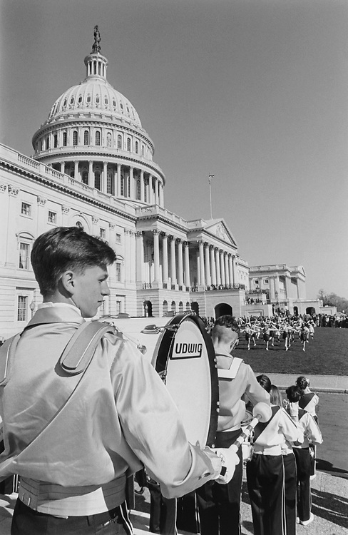 The Seaford High School Band from Seaford, New York, entertains the long line of tourist waiting to enter the Capitol Building on April 8, 1994. (Photo by Chris Martin/CQ Roll Call via Getty Images)