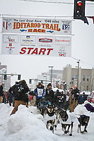 Rohn Buser leaves the 2011 Iditarod ceremonial start line in downtown Anchorage, during the 2012 Iditarod..Jim R. Kohl/Iditarodphotos.com