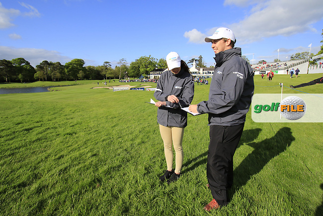 RSM timekeepers observe play on the 18th hole during Thursday's Round 1 of the 2016 Dubai Duty Free Irish Open hosted by Rory Foundation held at the K Club, Straffan, Co.Kildare, Ireland. 19th May 2016.<br /> Picture: Eoin Clarke | Golffile<br /> <br /> <br /> All photos usage must carry mandatory copyright credit (&copy; Golffile | Eoin Clarke)
