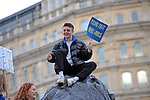 "Protestors on top of one of the lions at the base of Nelsons Column in Trafalgar Square in London during the ""Put it to the People"" rally which made it's way through central London today. Demonstrators from across the country gathered to call for a second referendum on Brexit and to march through the UK capital finishing with speeches in Parliament Square opposite the Houses of Parliament in Westminster."