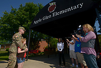 NWA Democrat-Gazette/BEN GOFF @NWABENGOFF<br /> Myra Cooper, 7, and her father Staff Sgt. William Cooper of Bentonville talk to the press Monday, May 8, 2017, after he surprised her in her classroom at Apple Glen Elementary School in Bentonville. Each week a parent comes in as a 'Mystery Reader' for their child's classroom at the school, with students receiving clues as to who it will be throughout the week. This week Myra was surprised by her father, who has been away from his family for over a year on deployment to Kuwait with the U.S. Army 77th Combat Aviation Brigade. Staff Sgt. Cooper read to the class from 'Harold and the Purple Crayon' by Crockett Johnson before taking Myra and the rest of their family to spend the day a the nearby Scott Family Amazeum.