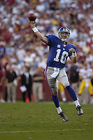 23 September 2007:  Giants QB Eli Manning (10) rolls out and throws on the run.  The New York Giants defeated the Washington Redskins 24-17 at FedEx Field in Landover, MD.