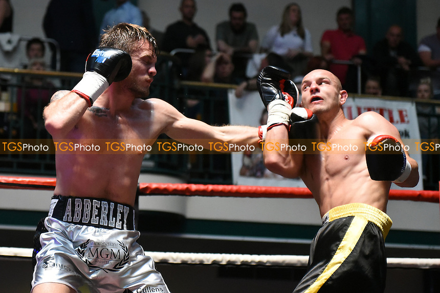 Danny Connor (silver/black shorts) defeats Andrej Moravek during a boxing show at York Hall on 14th May 2016