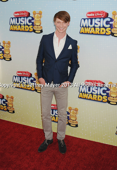 LOS ANGELES, CA- APRIL 27: Actor Calum Worthy arrives at the 2013 Radio Disney Music Awards at Nokia Theatre L.A. Live on April 27, 2013 in Los Angeles, California.