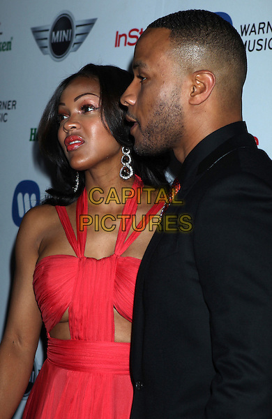 Meagan Good & guest.Warner Music Group 2013 Grammy Celebration held at The Chateau Marmont, West Hollywood, California, USA..February 10th, 2013.half length black suit red pink dress tie cut out away stubble facial hair under boob cleavage.CAP/ADM/RE.©Russ Elliot/AdMedia/Capital Pictures.