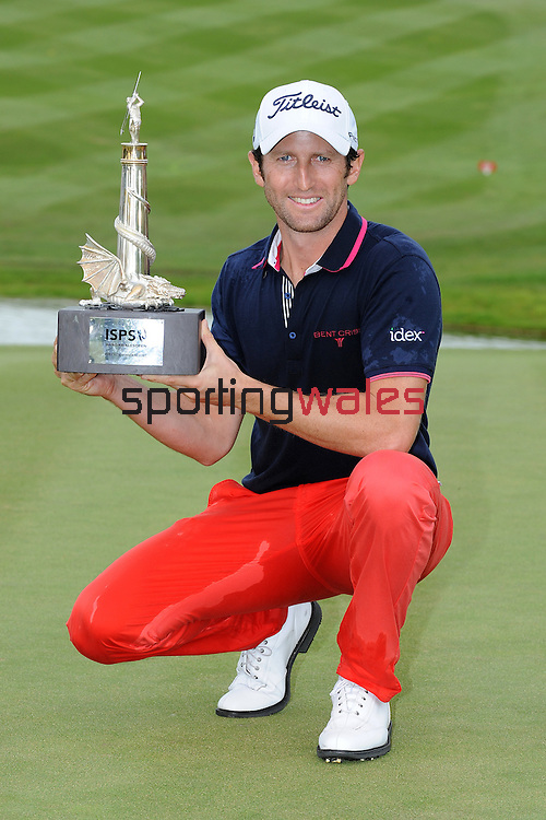 France's Gregory Bourdy with the ISPS Handa Wales trophy <br /> <br /> Golf - Day 4 - ISPS Handa Wales Open 2013 - Twenty Ten Course- Sunday 1st September 2013 - Celtic Manor Resort  - Newport<br /> <br /> © www.sportingwales.com- PLEASE CREDIT IAN COOK